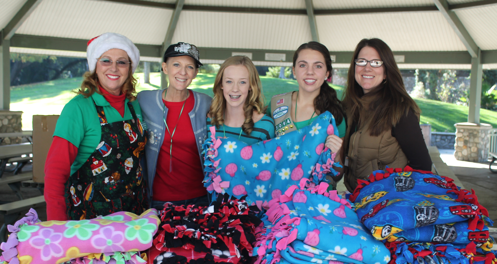 Vicki Brown with Sandy Boulware, Michelle Boulware, Danae Hollar and Lori Hollar. Danae made 30 tie blankets to hand out as part of a Girl Scout project.